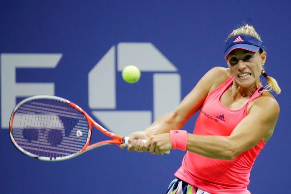 Angelique Kerber of Germany returns a shot to Petra Kvitova of the Czech Republic during her fourth round Women's Singles match on Day Seven of the 2016 US Open.