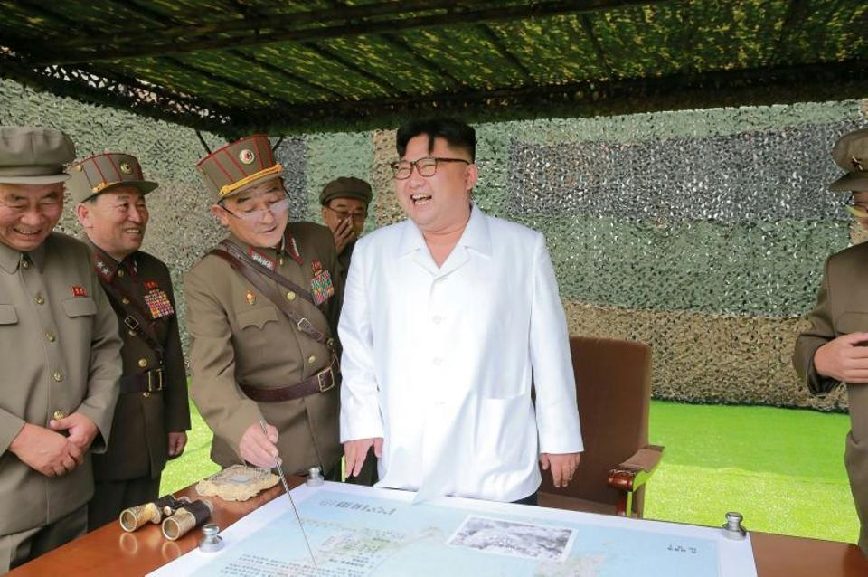 This undated picture released by North Korea's official Korean Central News Agency (KCNA) on September 6, 2016 shows North Korean leader Kim Jong-Un (C) inspecting the fire drill of ballistic rockets by Hwasong artillery units of the KPA Strategic Force.