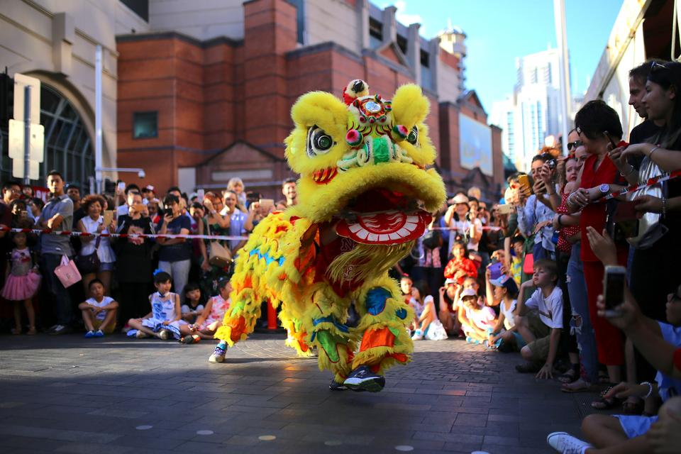 Performers dressed in costumes dance for spectators as part of celebrations for the Chinese Lunar New Year and marking the Year of the Dog in Sydney, Australia, February 16, 2018.