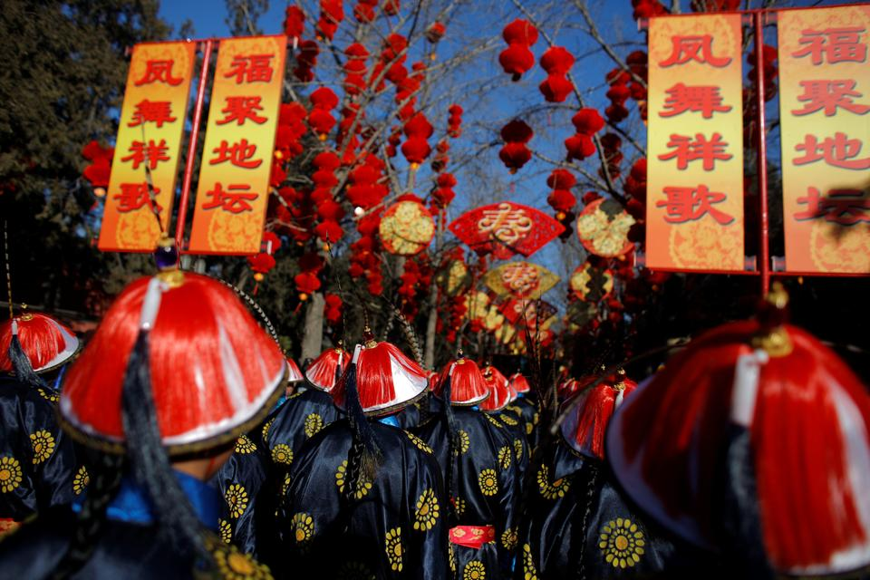 Performers take part in the re-enactment of a Qing Dynasty ceremony, in which emperors prayed for good harvest and fortune for the Chinese New Year, during the Spring Festival Temple Fair at the Temple of Earth in Ditan Park in Beijing, China, February 16, 2018.