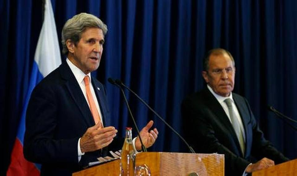 John Kerry and Sergei Lavrov hold a press conference following their meeting in Geneva, Switzerland where they discussed the crisis in Syria September 9. Source: Reuters