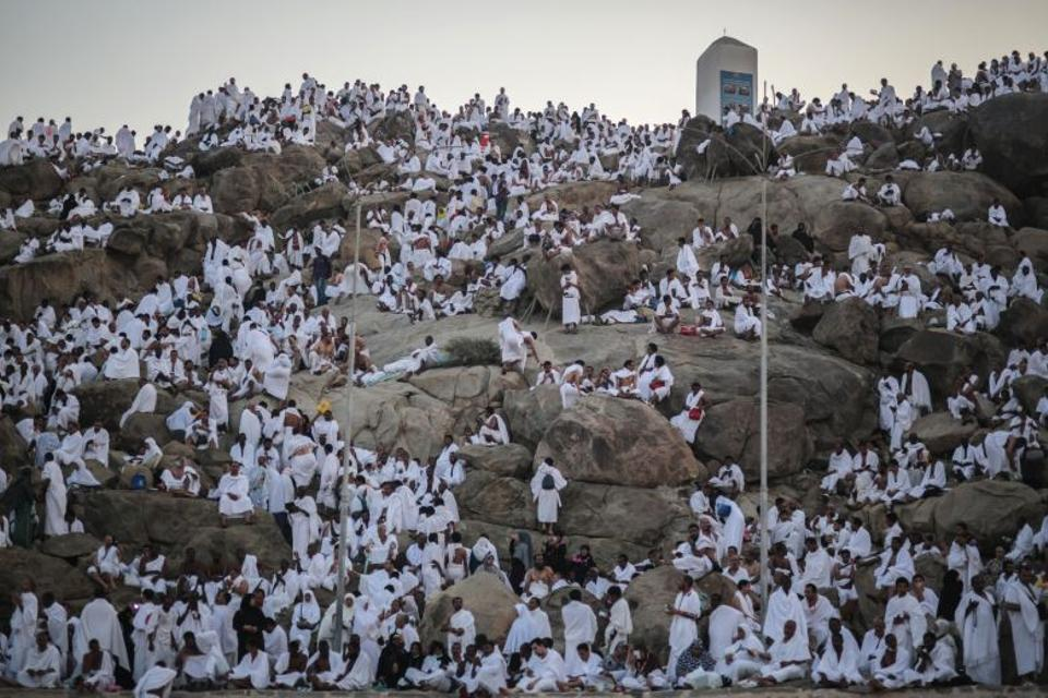 Muslim pilgrims pray on a rocky hill called the Mountain of Mercy, on the Plain of Arafat, near the holy city of Mecca, Saudi Arabia, Sept. 23, 2015, during the Hajj pilgrimage. (AP Archive)