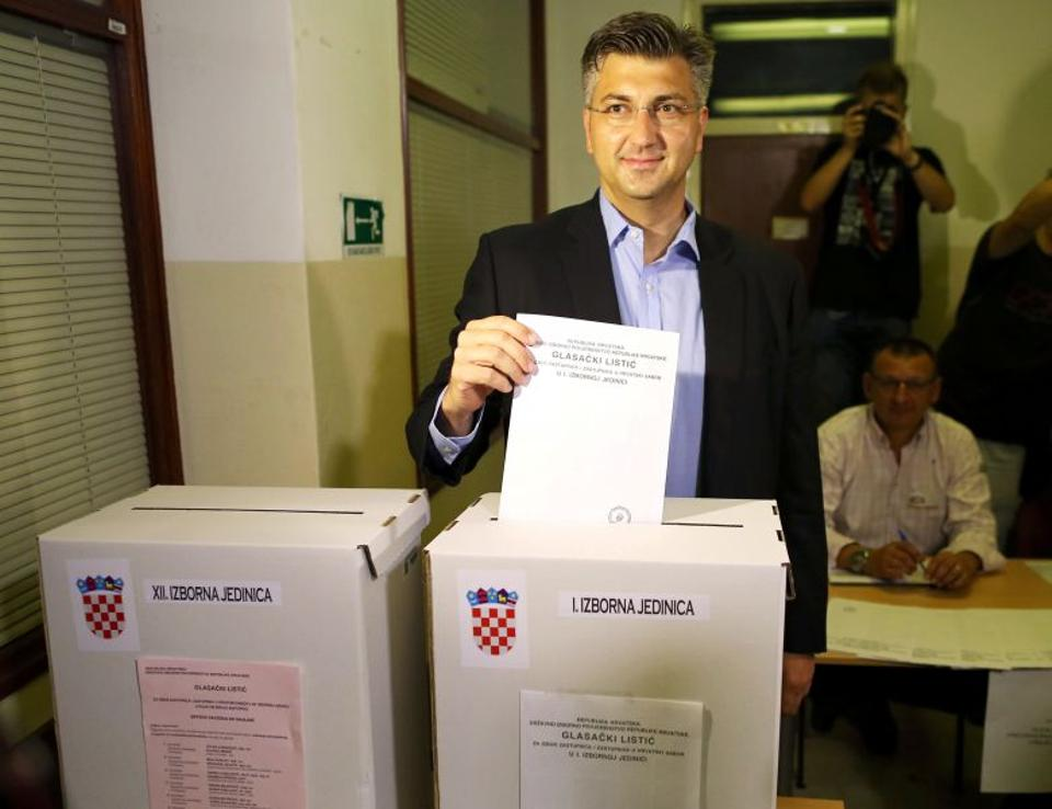 Andrej Plenkovic, president of the Croatian Democratic Union (HDZ), casts his ballot at a polling station during a parliamentary election in Zagreb, Croatia, September 11, 2016. (Reuters)