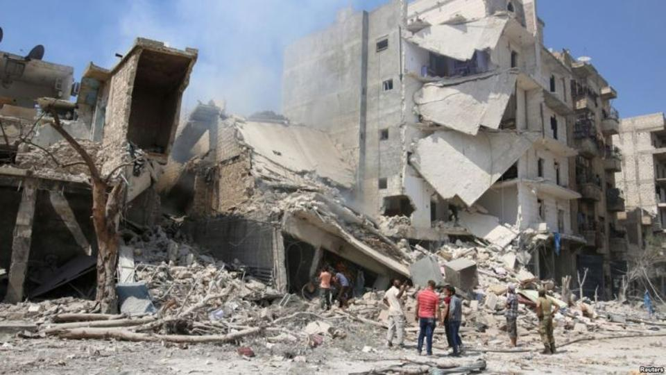 Men inspect a damaged site after double airstrikes on the opposition held Bab al-Nairab neighborhood of Aleppo.