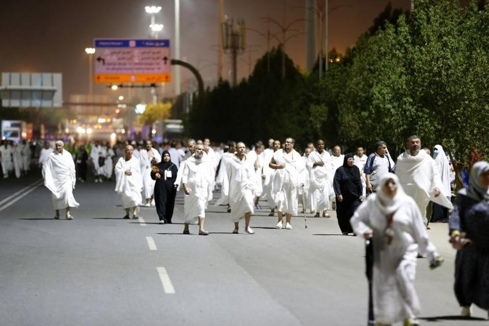 Muslim pilgrims walk towards a rocky hill known as Mount Arafat on September 10, 2016 to prepare for the climax of the annual hajj pilgrimage, near the Saudi holy city of Mecca.