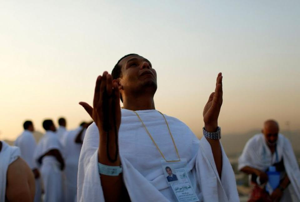 Muslim pilgrim prays on Mount Mercy on the plains of Arafat during the annual haj pilgrimage, outside the holy city of Mecca.