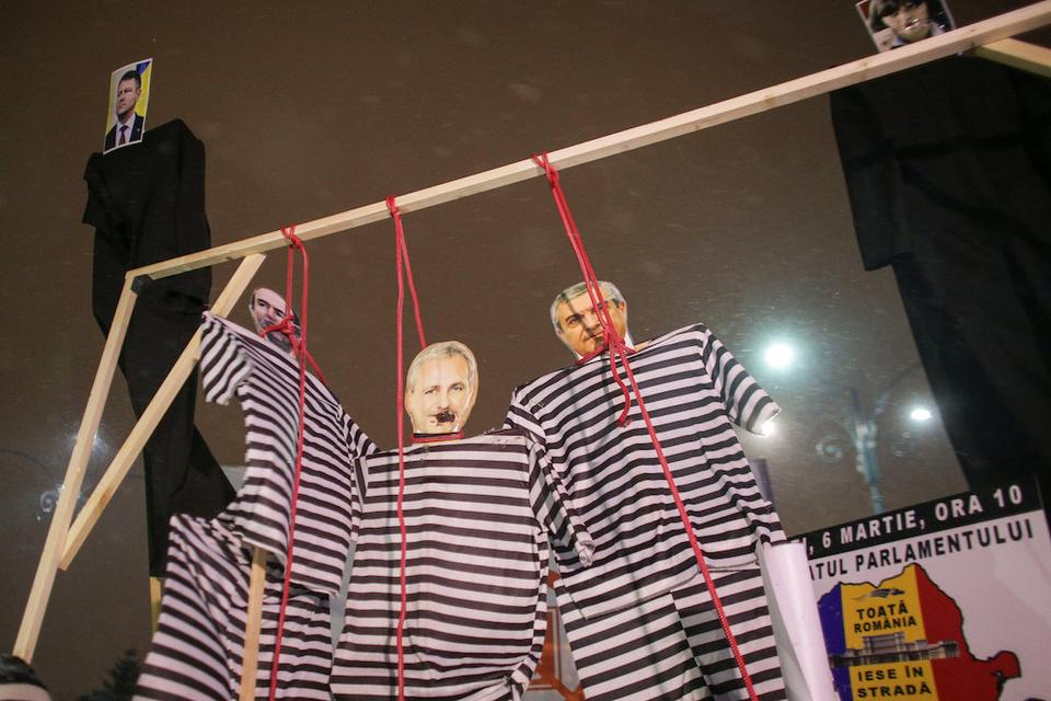 Cardboard cutouts of the Romanian Justice Minister Tudorel Toader, Social Democrat Party leader Liviu Dragnea and Senate president Popescu Tariceanu dressed in prison garb are seen while people protest a government move to call for the sacking of the country's chief anti-corruption prosecutor in Bucharest, Romania, February 25, 2018.