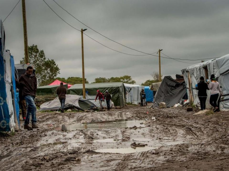Calais 'Jungle' camp is home to some 7,000 refugees but charities say the number might be as high as 10,000 after an influx this summer.