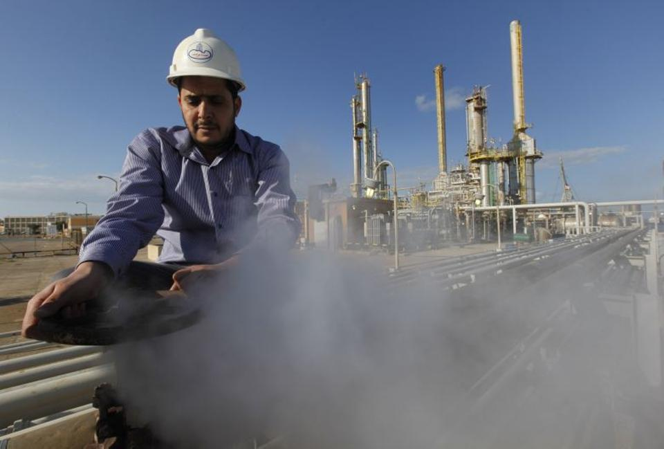 A Libyan oil worker at a refinery inside the Brega oil complex in the east of the nation. Libya's deputy oil minister said the country's oil exports are five times less than what they were prior to the 2011 war that toppled longtime ruler Moammar Gadhafi.