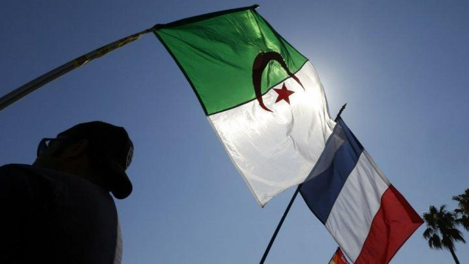 An Algerian flag flies alongside a French Flag. Algeria gained its independence from France in 1962.