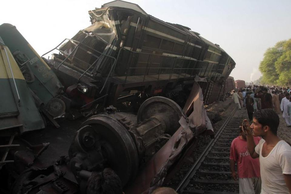 Bystanders gather at the site of the collision of two trains on the outskirts of Multan on September 15, 2016.