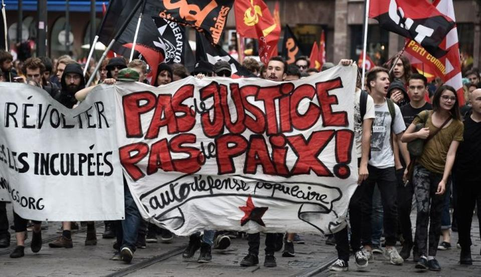 Demonstrators march with a banner reading 'No justice, no freedom' during a demonstration against the controversial labour reforms of the French government in Strasbourg, eastern France, on September 15, 2016