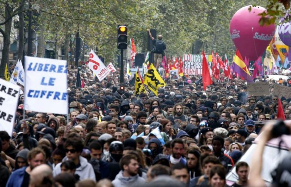 People take to the streets during a demonstration against the controversial labour reforms of the French government in Paris on September 15, 2016