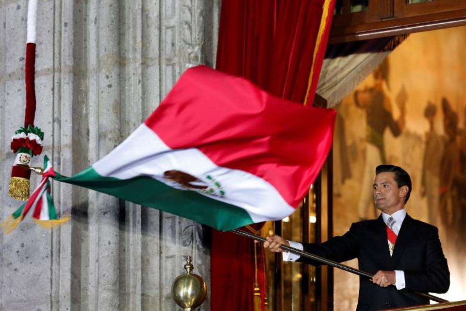 Mexico's President Enrique Pena Nieto waves the national flag after he shouted the