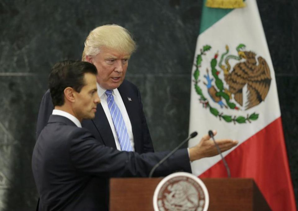 US Republican presidential nominee Donald Trump and Mexico's President Enrique Pena Nieto arrive for a press conference at the Los Pinos residence in Mexico City, Mexico, August 31, 2016.