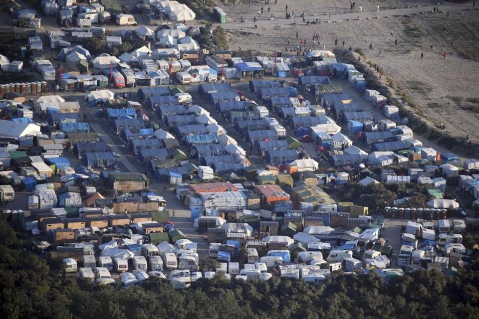 An aerial view shows makeshift shelters and tents where migrants live in what is known as the