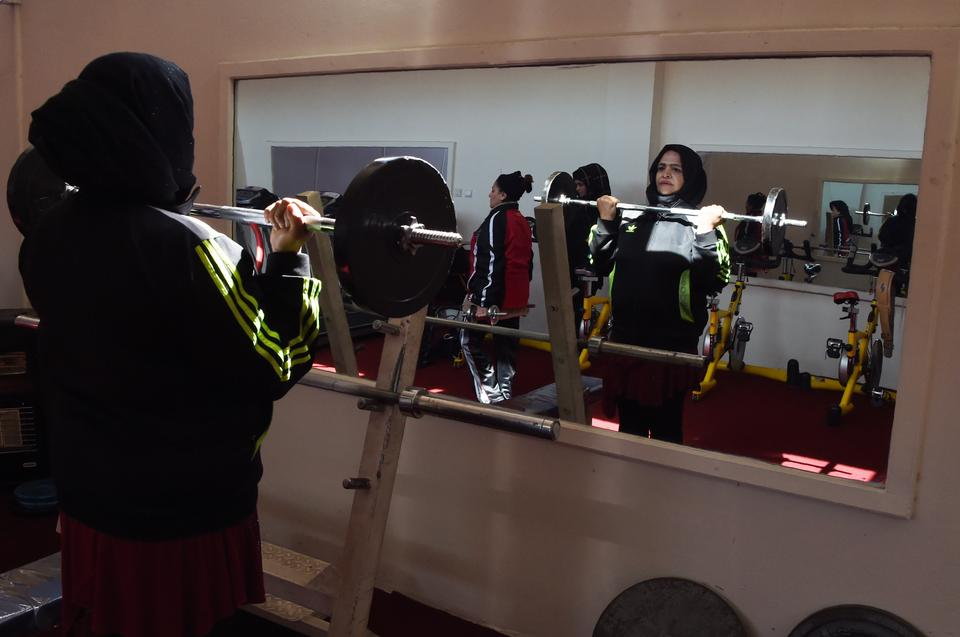 Afghanistan national powerlifting team member Rasheda Parhiz, 40, lifts weights during a training session at a women's gym at Ghazi stadium in Kabul.