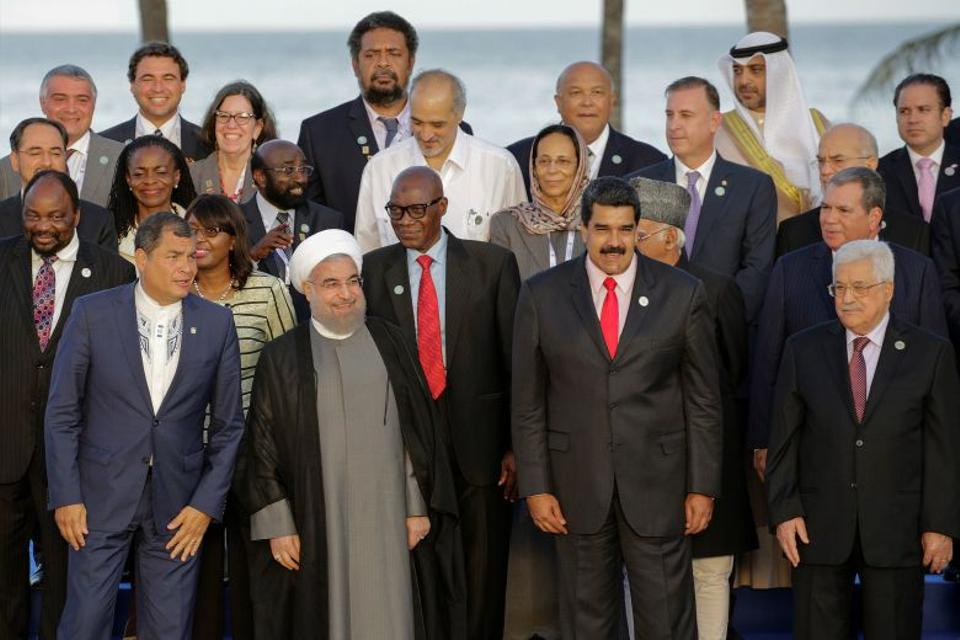 Ecuador's President Correa, Venezuela's President Maduro, Iranian President Rouhani, Palestinian President Abbas and other presidents, leaders and head of delegations pose for a photo during the 17th Non-Aligned Summit. Source: Reuters