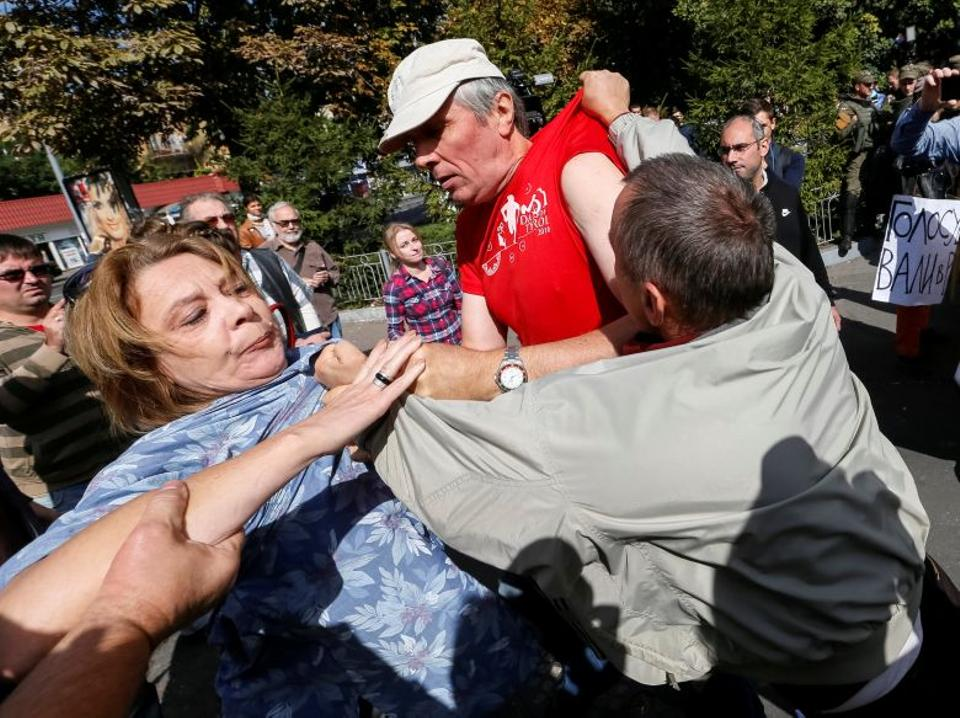 People scuffle in front of the Russian embassy in Kiev on September 18, 2016. (Reuters)