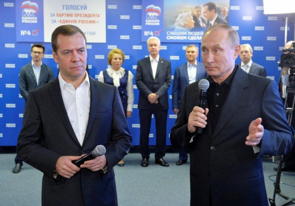 President Vladimir Putin and Prime Minister Dmitry Medvedev visit United Russia's campaign headquarters after a parliamentary election that exit polls suggest will see Putin's party consolidate power.