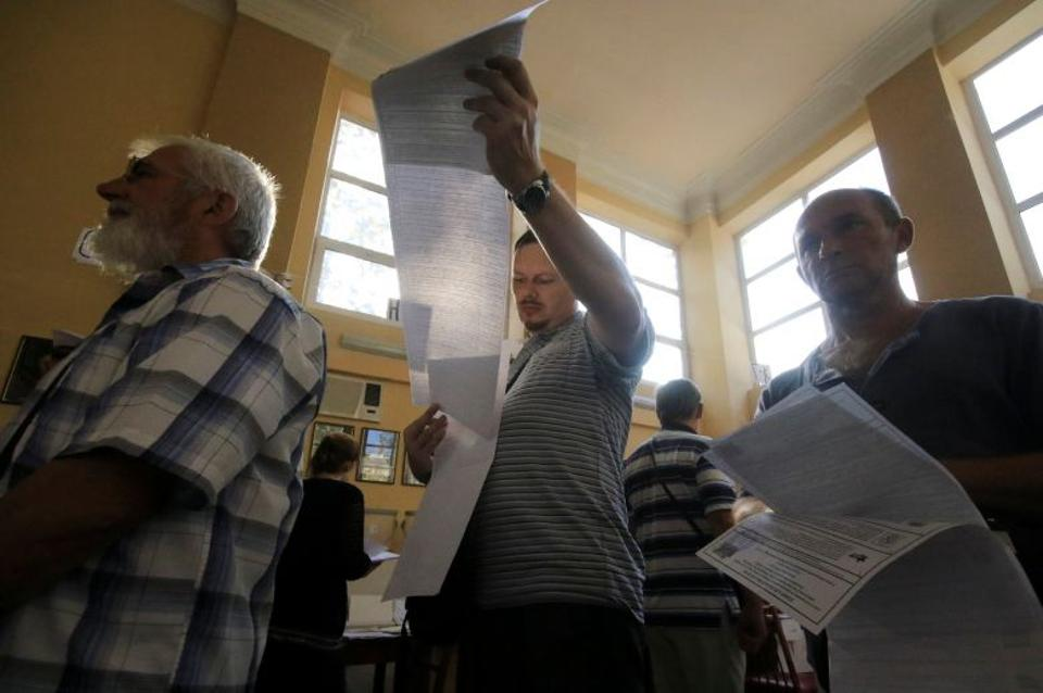 People visit a polling station during the Russian parliamentary election in Sevastopol, Crimea, September 18, 2016.