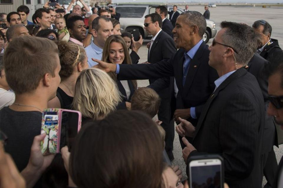 US President Barack Obama shakes hands with spectators as he arrives at John F. Kennedy International Airport in New York, NY, on September 18, 2016.