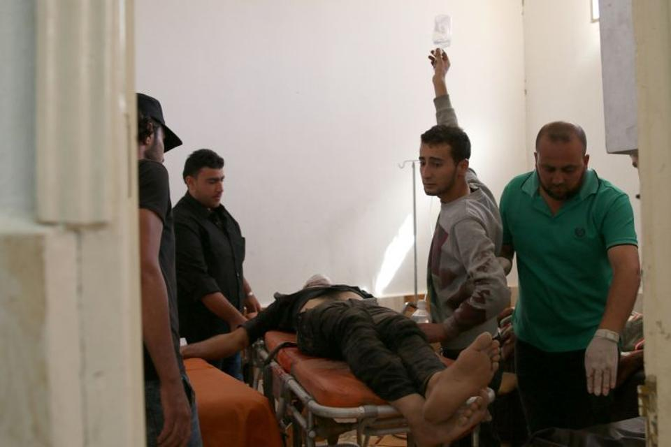 People move an injured man inside a field hospital after an airstrike in the opposition-held town of Dael, in Daraa Governorate, Syria September 18, 2016. (Reuters)