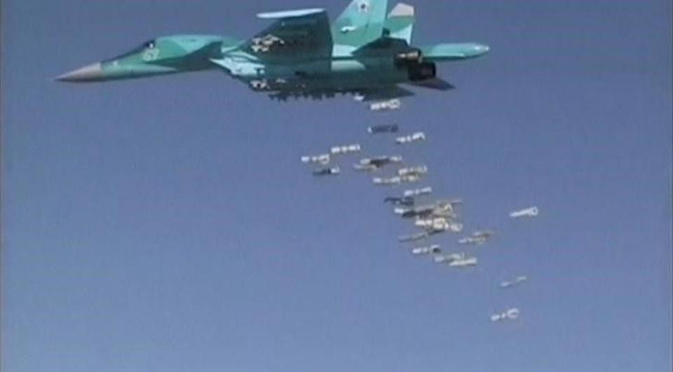 Russian Sukhoi Su-34 fighter-bomber dropping off bombs in the Syrian province of Deir ez-Zor.