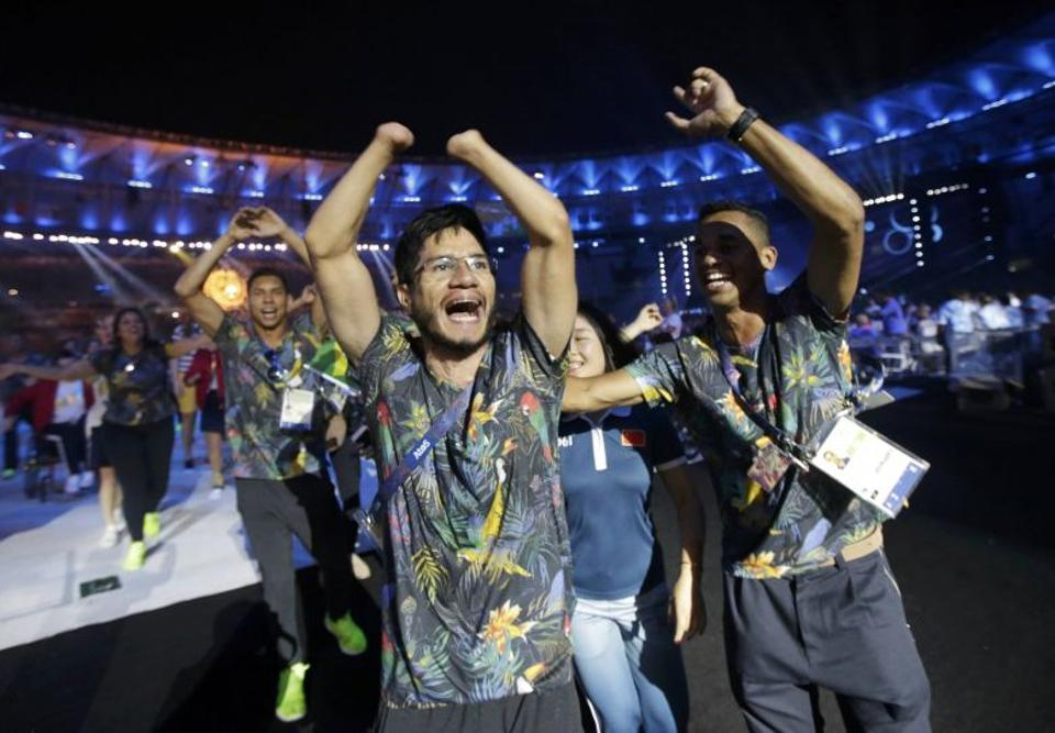 Brazilian athletes take part in the closing ceremony.