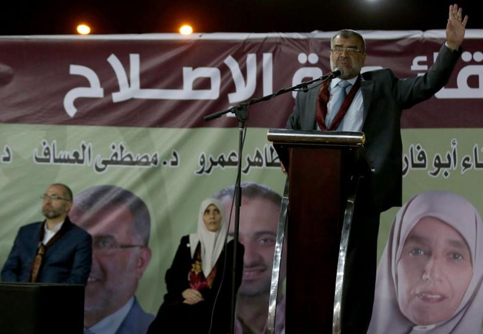 IAF candidate Mustafa al-Assaf speaks during a campaign conference for the National Alliance for Reform in Amman's Sweileh district late on September 16, 2016. (AFP)