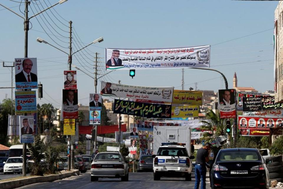 Electoral posters for parliamentary candidates are seen ahead of the general elections on Tuesday, in Madaba city, near Amman, Jordan, September 19, 2016. (Reuters)