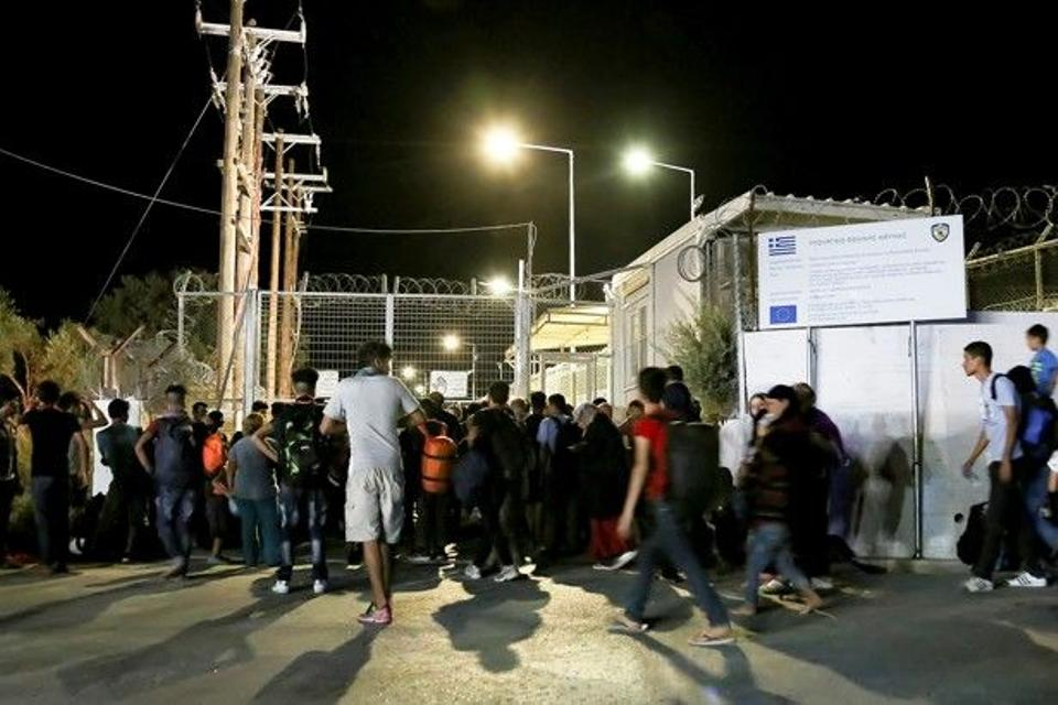 Migrants gather outside a Lesbos refugee camp after a fire forced them to flee.