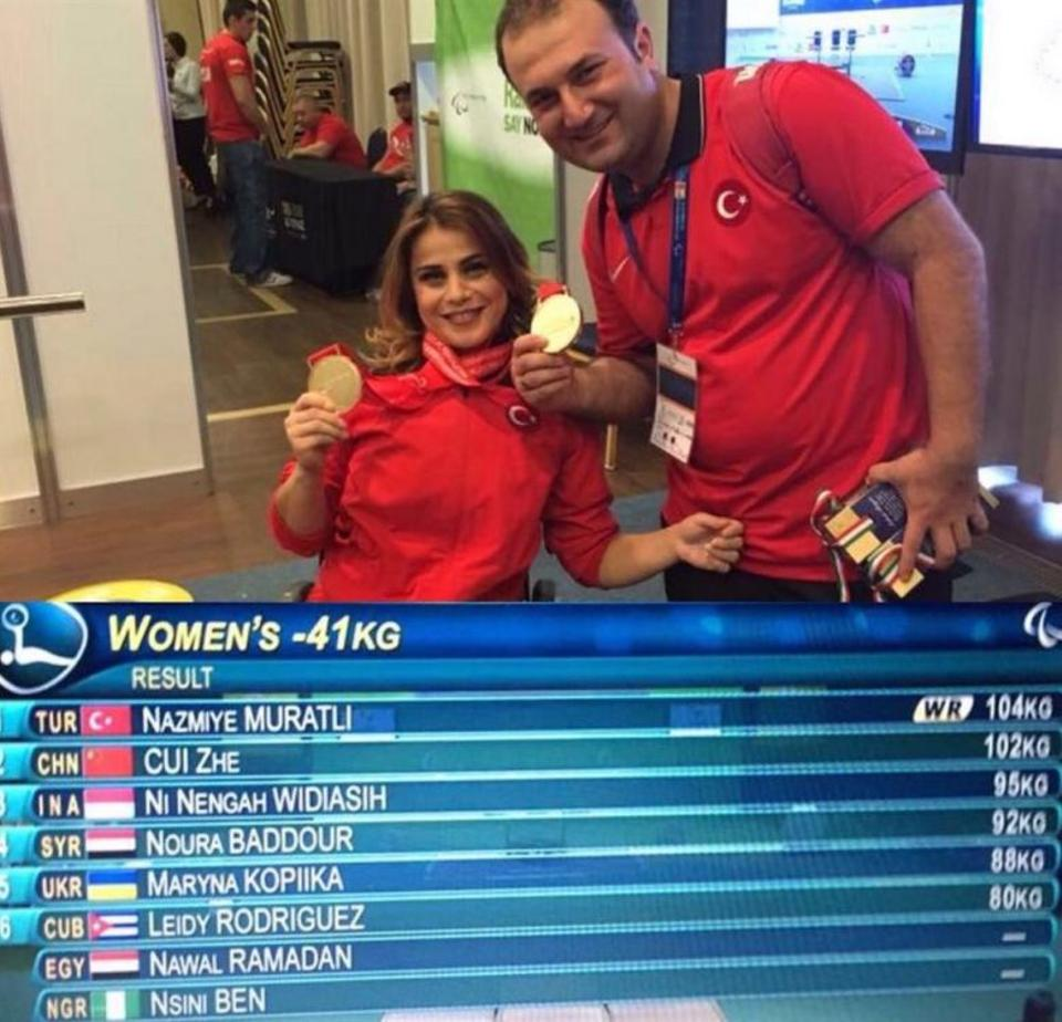 Turkish female weightlifter Nazmiye Muratli displays her gold medal in Rio.