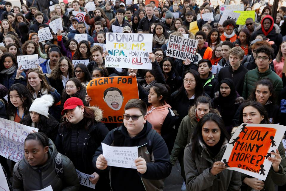 Students participate in a march in support of the National School Walkout in the Queens borough of New York City, New York, US, March 14, 2018.
