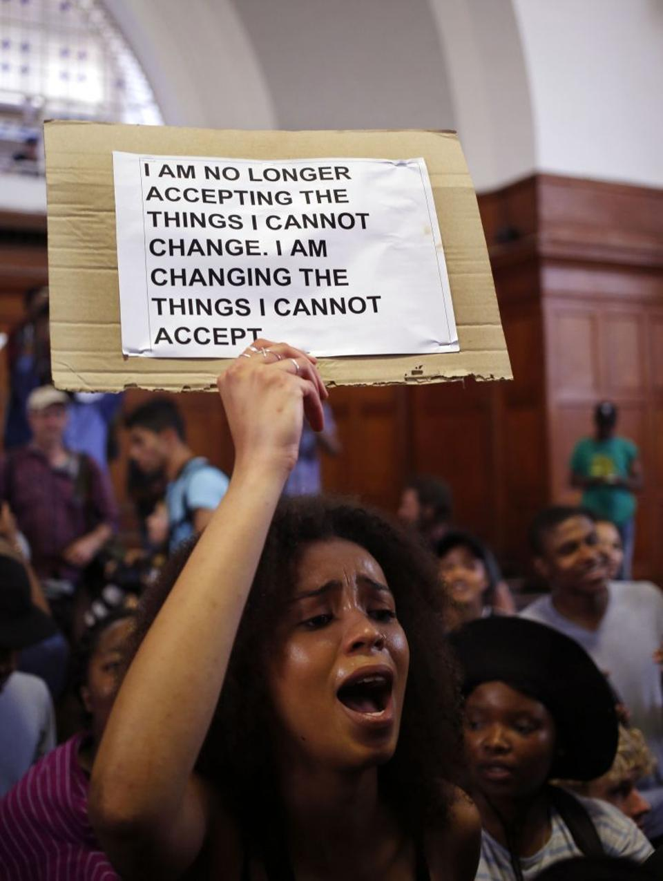 Students from the University of Cape Town chant and sing as they gather to discuss possible student fee increases at there campus in Cape Town, South Africa, Monday, Sept. 19, 2016. Image: AP