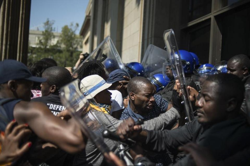 Students from the University of the Witwatersrand clash with university security guards during a demonstration against university fee hikes, on September 20, 2016, in Johannesburg. Image: AFP