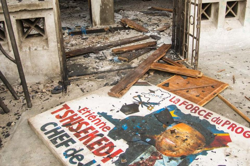 Picture taken on September 20, 2016 in Kinshasa shows the entrance of offices of the main opposition Union for Democracy and Social Progress (UDPS) party which were torched overnight and early on September 20, 2016.