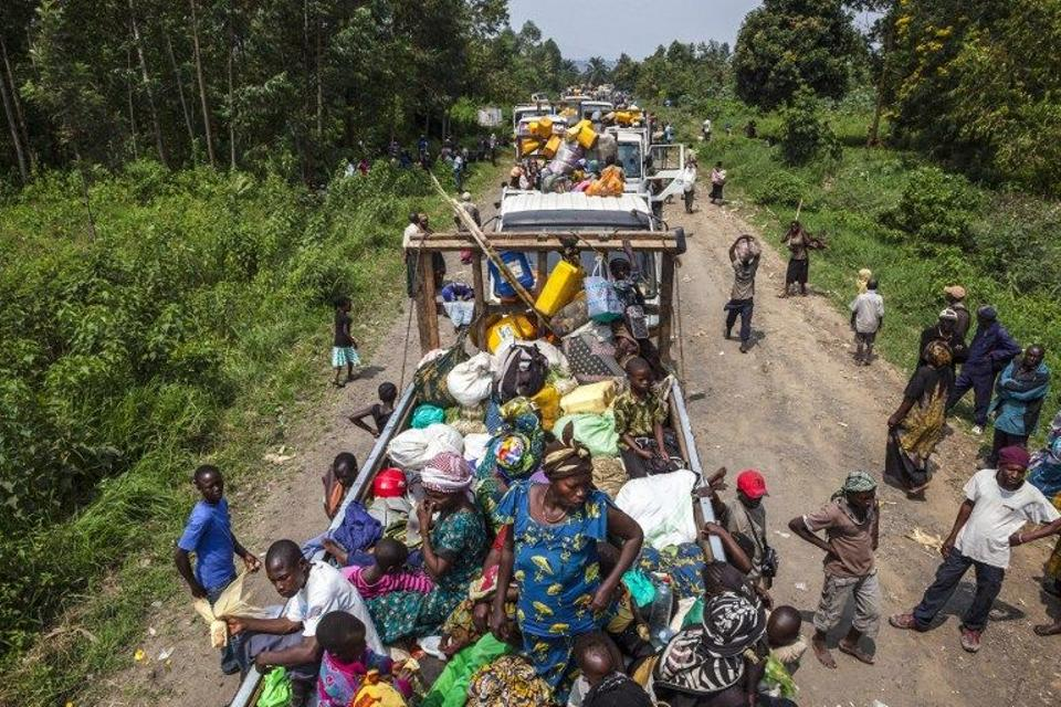People wait on trucks for the Congolese army convoy to start in order to insure security in face of a wave of civilian kidnappings between the villages of Kiwanja and Kanyabayonga,in the troubled southeastern part of the province of North Kivu.