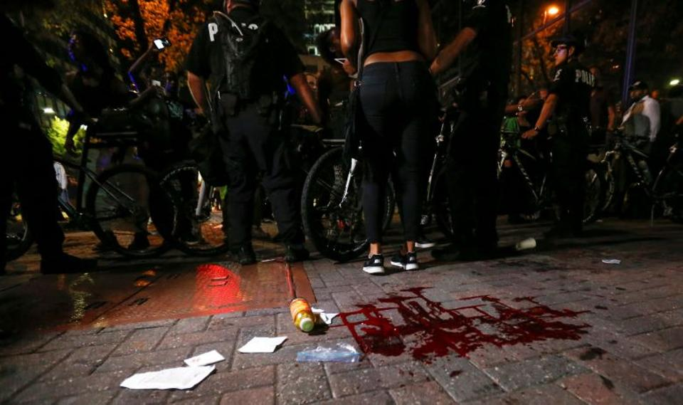Blood covers the pavement where a person was shot in uptown Charlotte, NC during a protest of the police shooting of Keith Scott, in Charlotte, North Carolina, U.S. September 21, 2016.