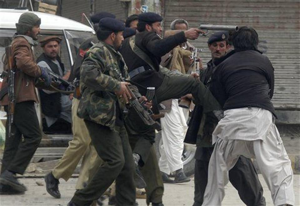 Pakistani police officers beat a protester in Quetta, Pakistan on Jan. 26, 2009, during a protest following the murder of a religious leader. Source: AP