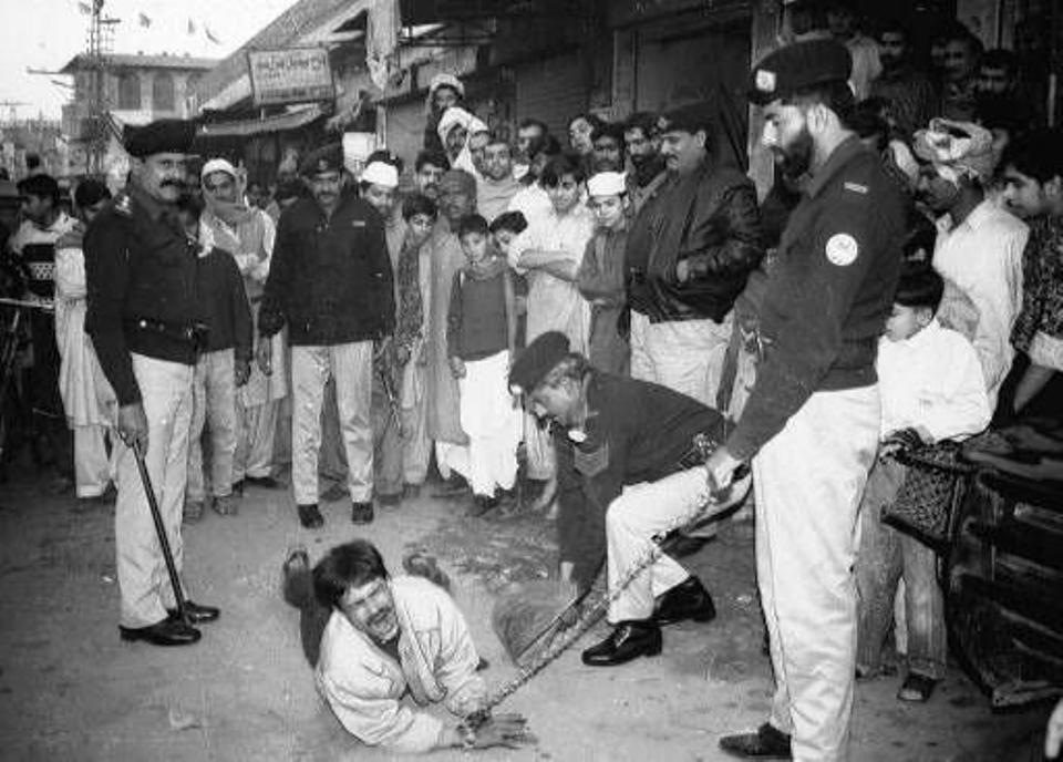 Nadeem Butt, a notorious local drug seller, is publically beaten by police in Lahore Saturday, Jan. 10, 1998. Source: AP