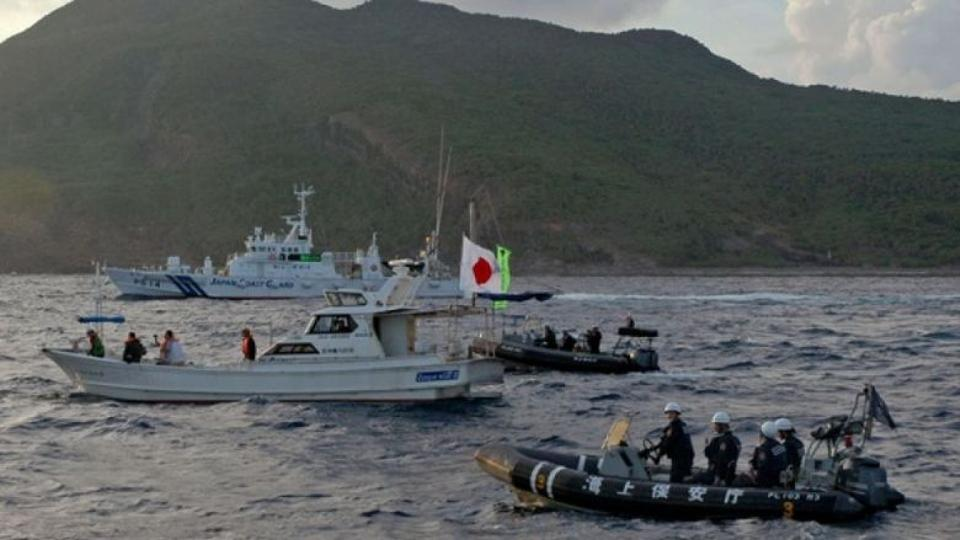 Japanese Coast Guard vessels sail near one of the isles' known as the disputed islands which are Japan calls Senkaku and China calls Diaoyu.