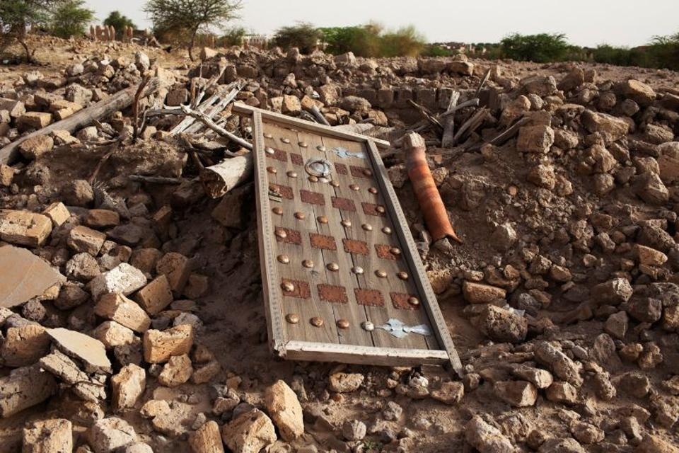 The rubble left from an ancient mausoleum destroyed by militants, is seen in Timbuktu, July 25, 2013.