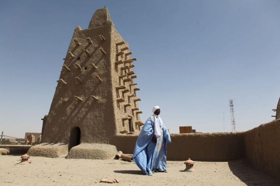 A man stands in front of the Djingareyber mosque in Timbuktu, central Mali.