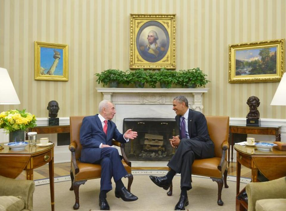 This file photo taken on June 25, 2014 shows US President Barack Obama meeting with Israeli President Shimon Peres in the Oval Office of the White House in Washington, DC.