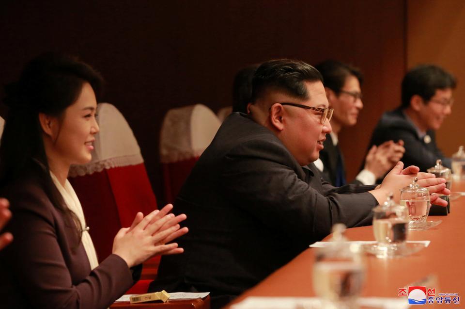c15adf5663e3 North Korean leader Kim Jong-un and his wife Ri Sol-ju watch South