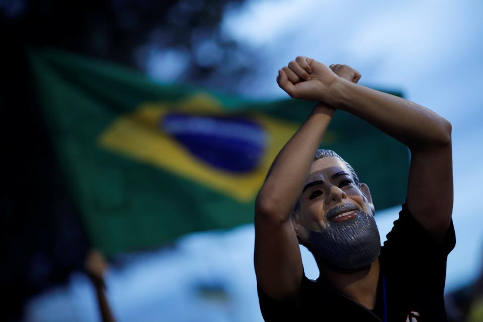 A demonstrator wearing a mask depicting Brazil's former President Luiz Inacio Lula da Silva takes part in a protest in Brasilia, Brazil, on April 3, 2018.