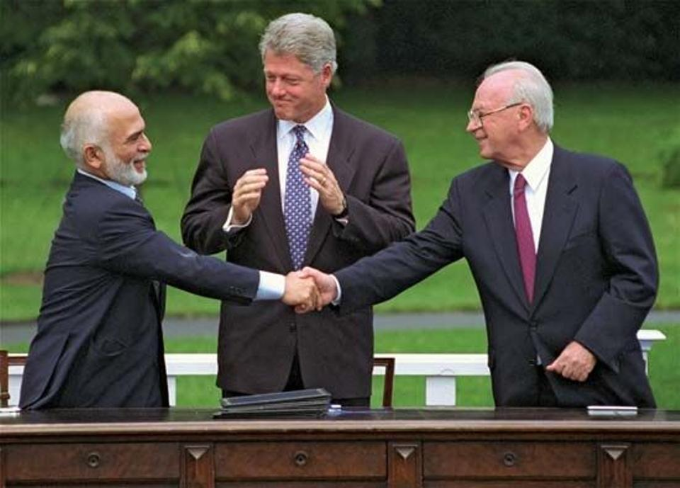 Closing the deal, a handshake between King Hussein and former Israeli Prime Minister Rabin ending over 46 years of hostilities. Accompanied by US President Bill Clinton, during the Israel-Jordan peace negotiations, July 25.