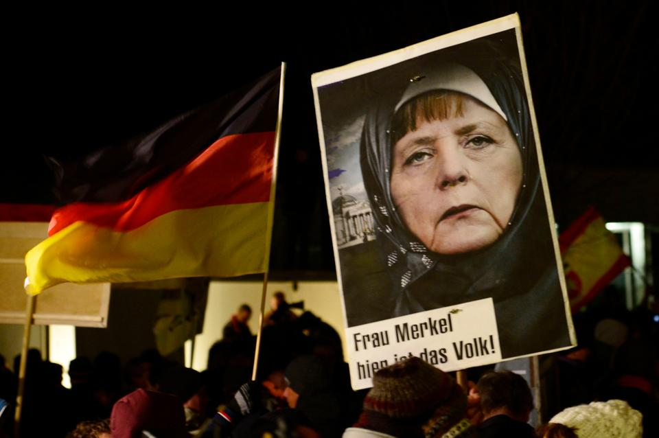 In  January 2015,  racist groups mocked German Chancellor Angela Merkel by carrying placards with photoshopped images of Merkel, criticising her for not being hard on German Muslims.