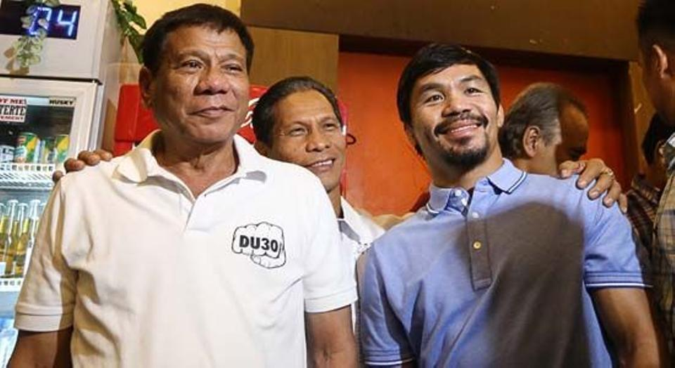 Philippines President Rodrigo R. Duterte (L) with boxing icon and Senator Emmanuel D. Pacquiao. Source: AFP